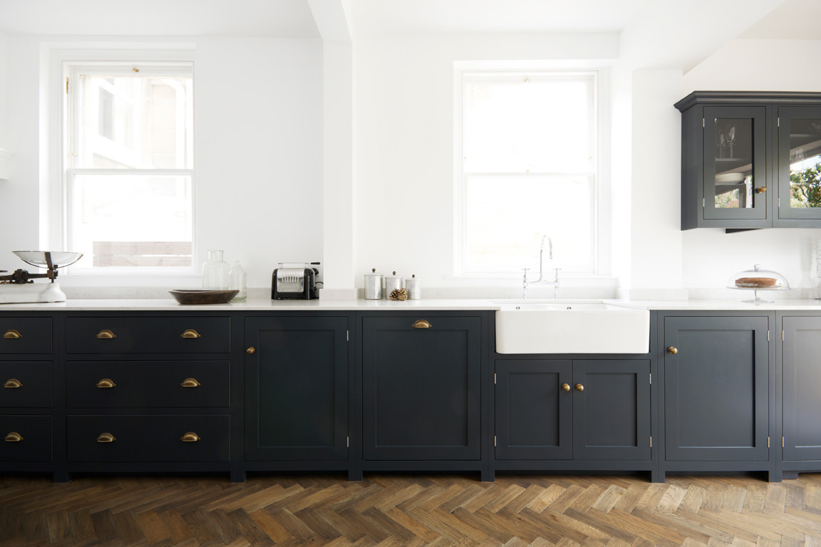 Pantry blue and parquet a perfect match the devol for Dark blue kitchen cabinets