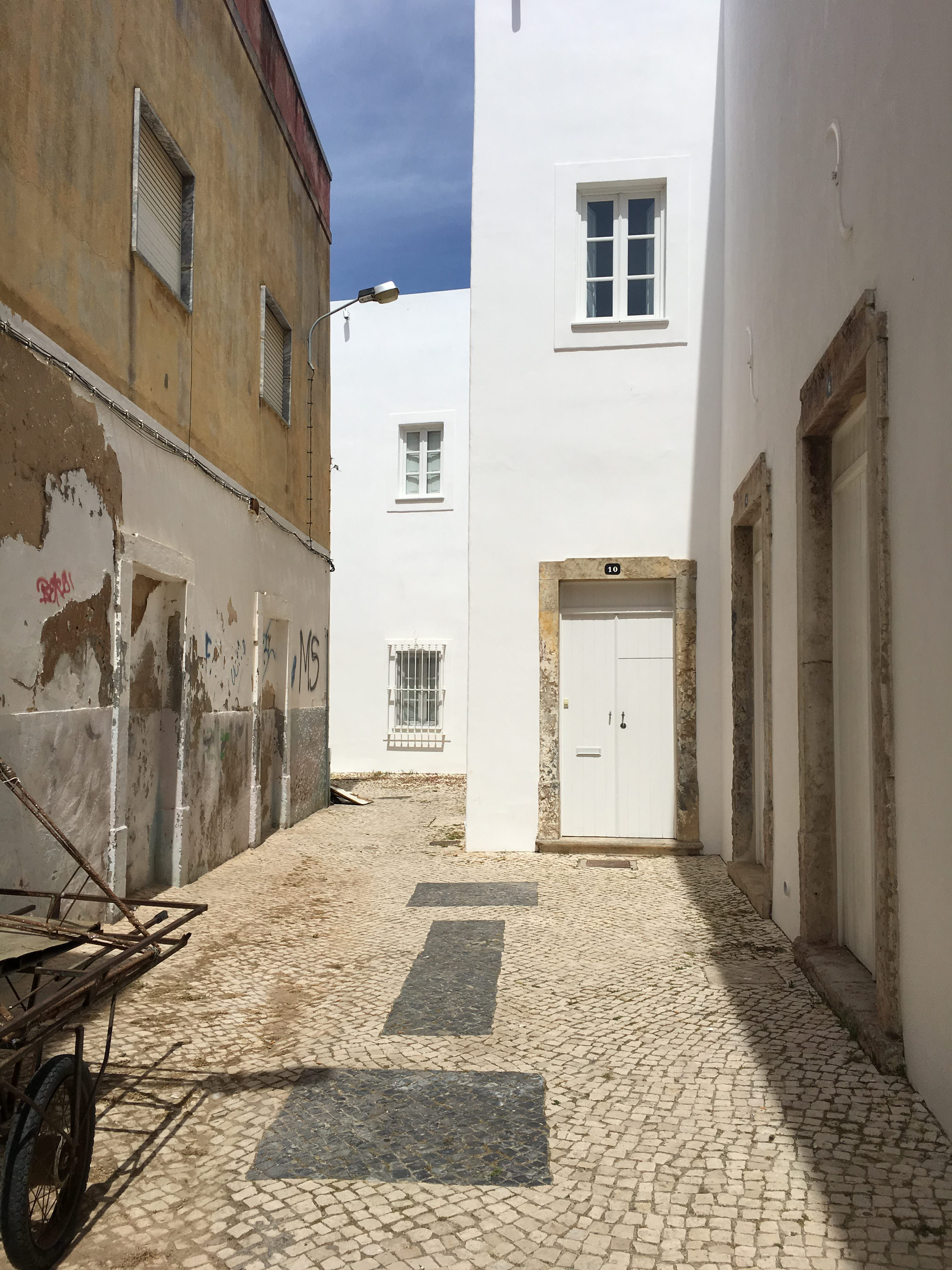 The front door to Convento, no signs, just freshly painted and down a cobbled street.