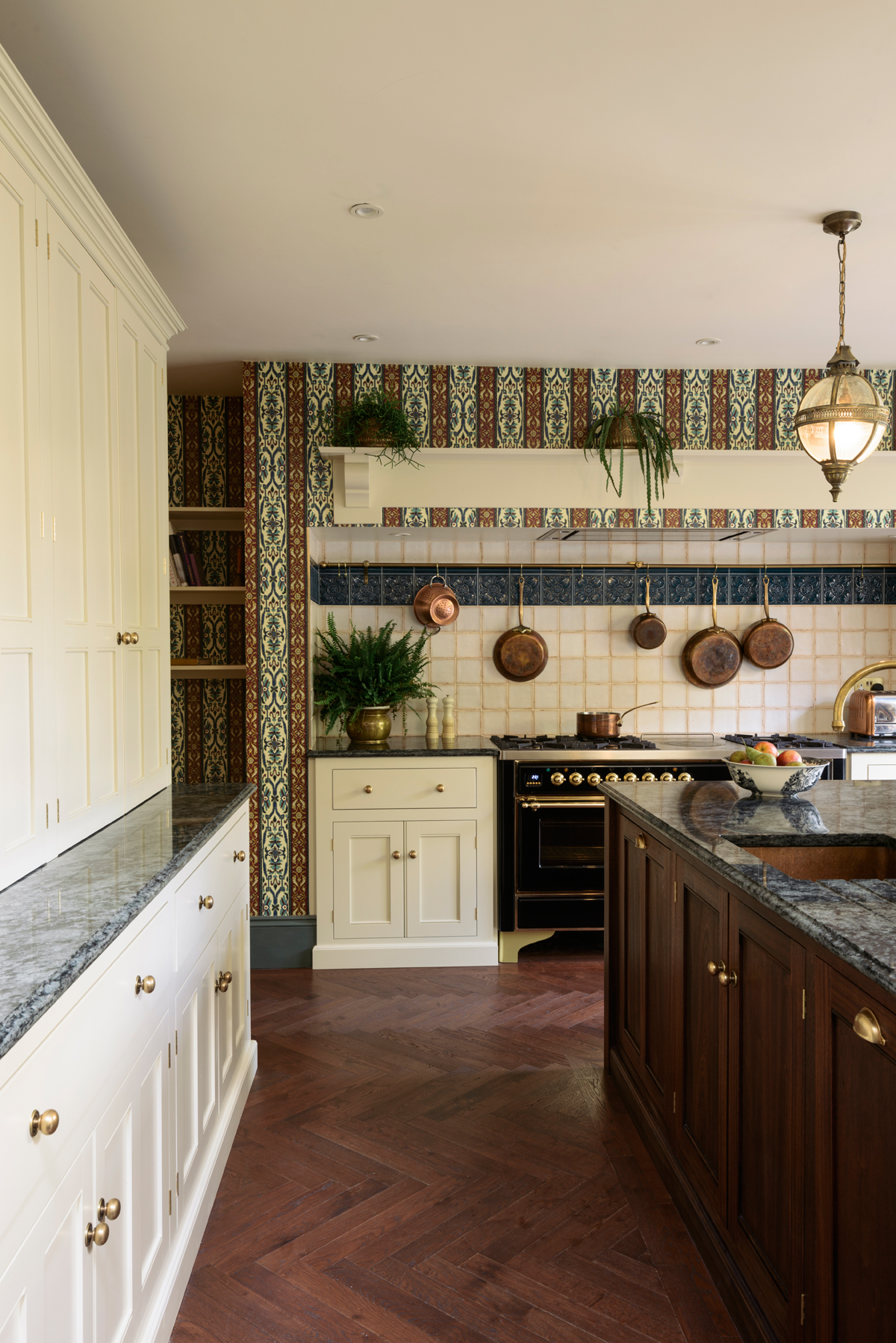 Collections of shimmering copper pans hung from an aged brass rail above the range