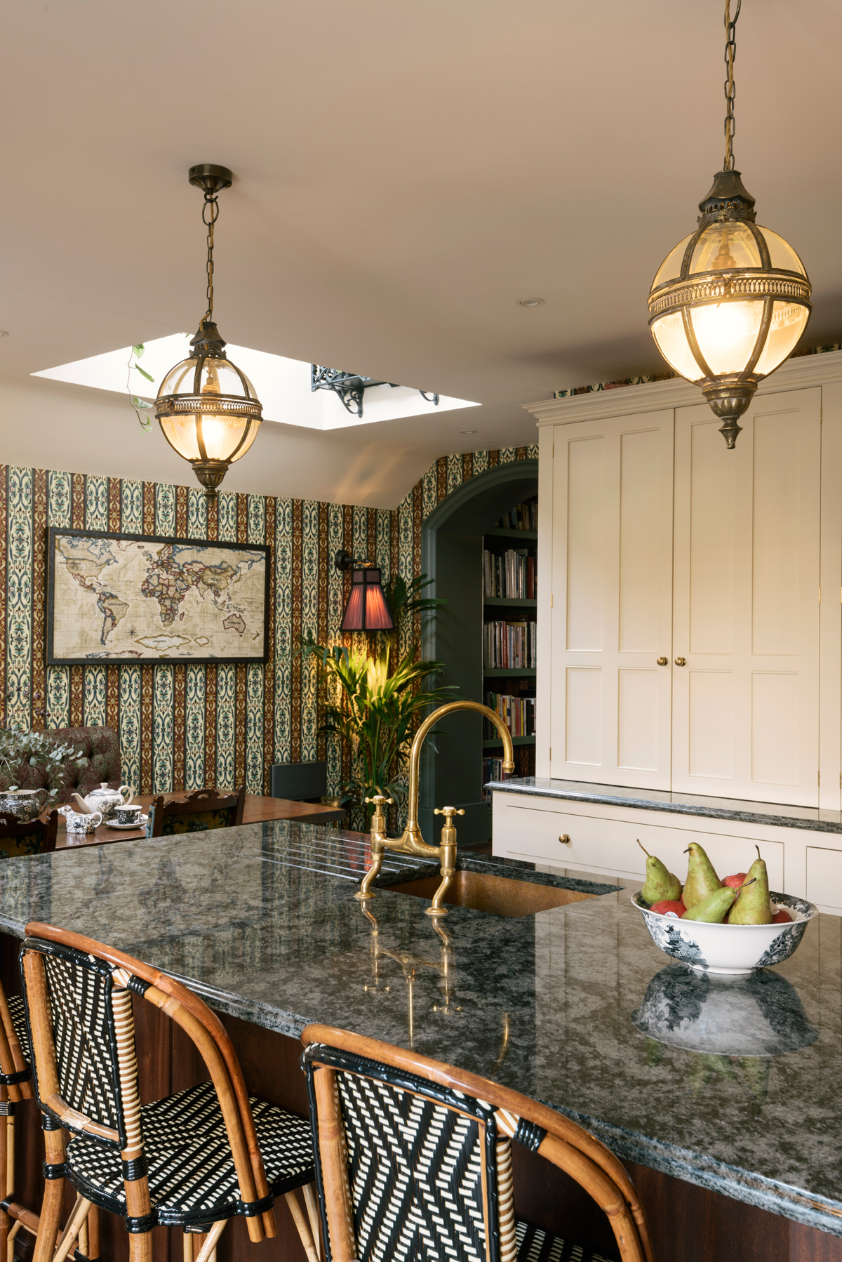 Tall bespoke cupboards painted in Linen kept the room feeling bright and fresh.