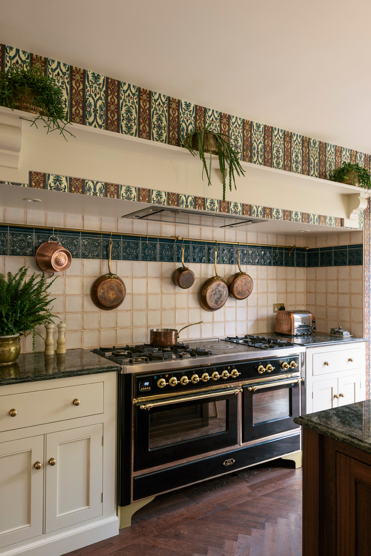 Beautifully worn tiles were used for the splashback, they're from Fired Earth but look as though they could always have been there
