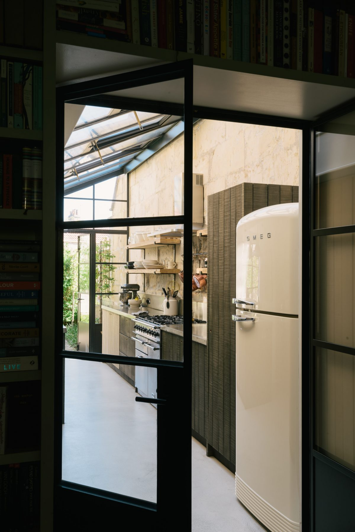 A view through Crittall-style doors into this cool Sebastian Cox Kitchen.