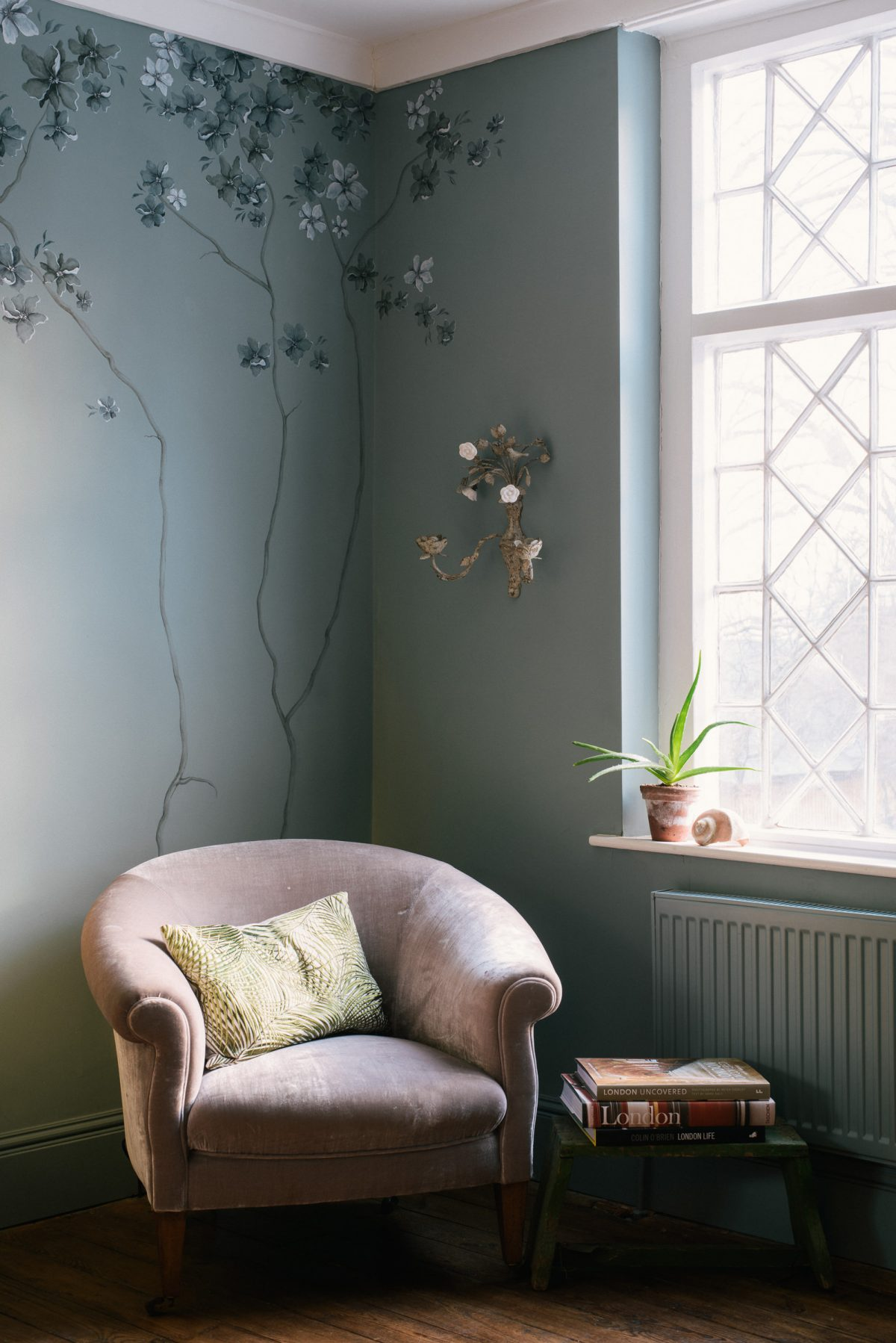 The branches I painted on this wall were very subtle and fitted so nicely behind this old velvet chair.