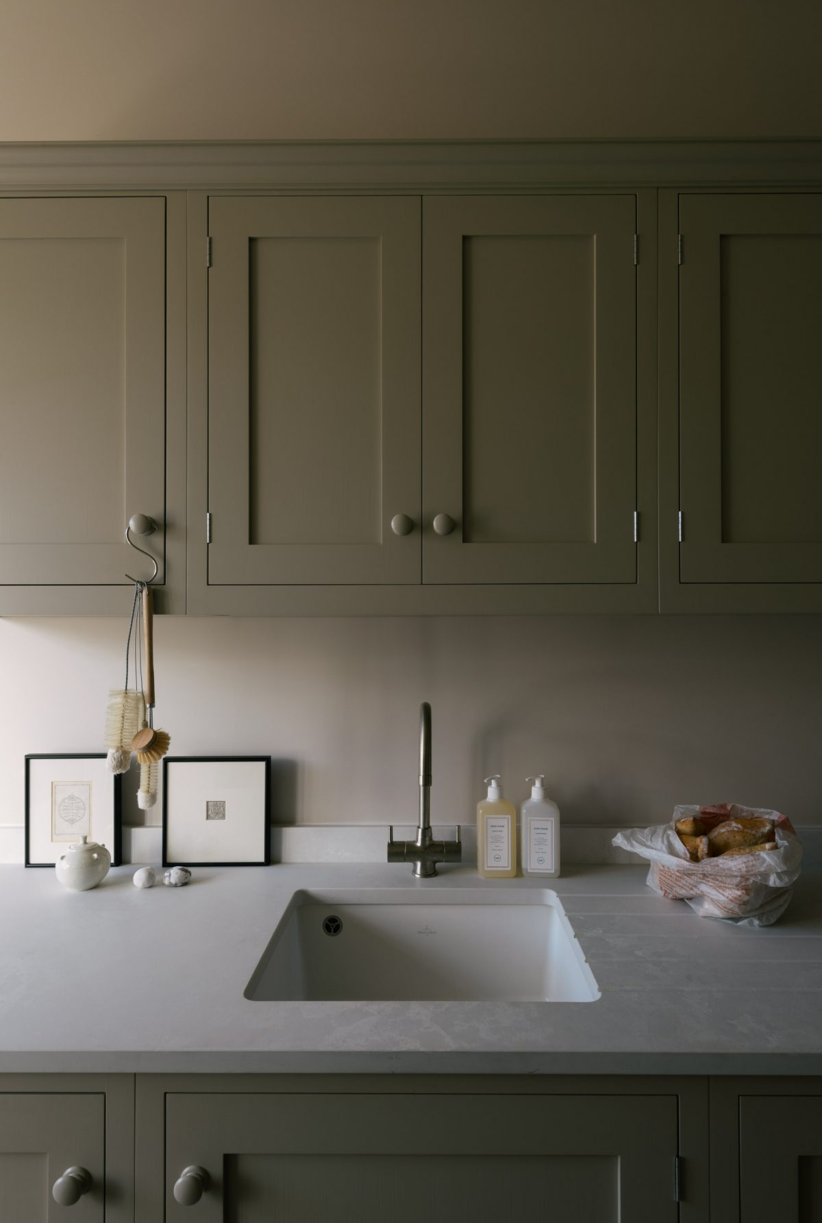 The Bath Kitchen features a manmade surface by Caesarstone, it looks pale, sleek and will take a great deal of use.