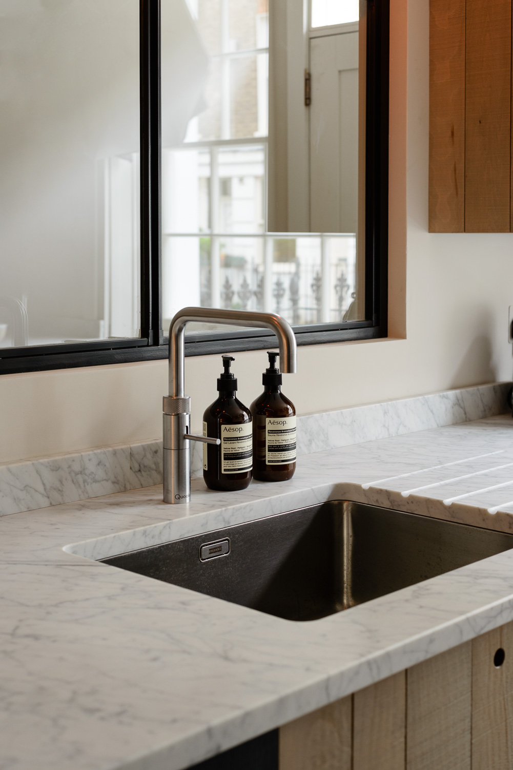 Much less shiny and reflective, this Carrara marble has a honed finish.