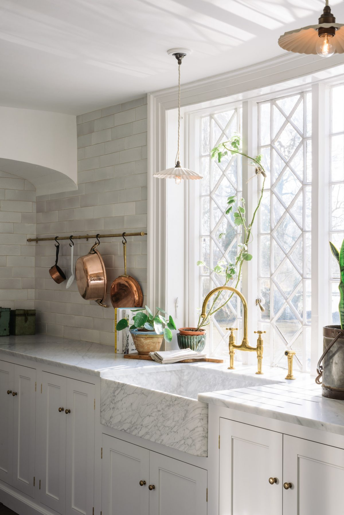 Carrara marble worktops and a deVOL Milano Penthouse marble sink, a dreamy combination.