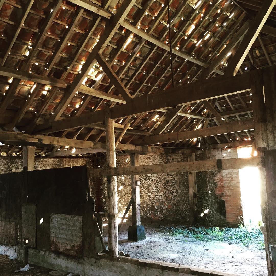 An old cattle shed before a beautiful renovation