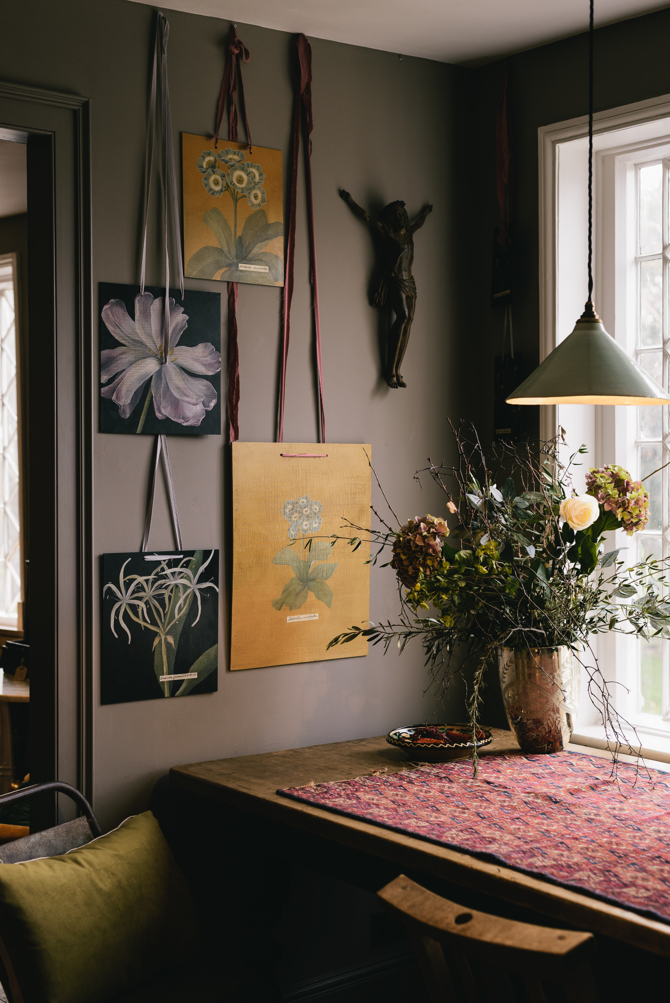 Hanging botanical paintings created by our in-house Decorative Artist, Rosie.