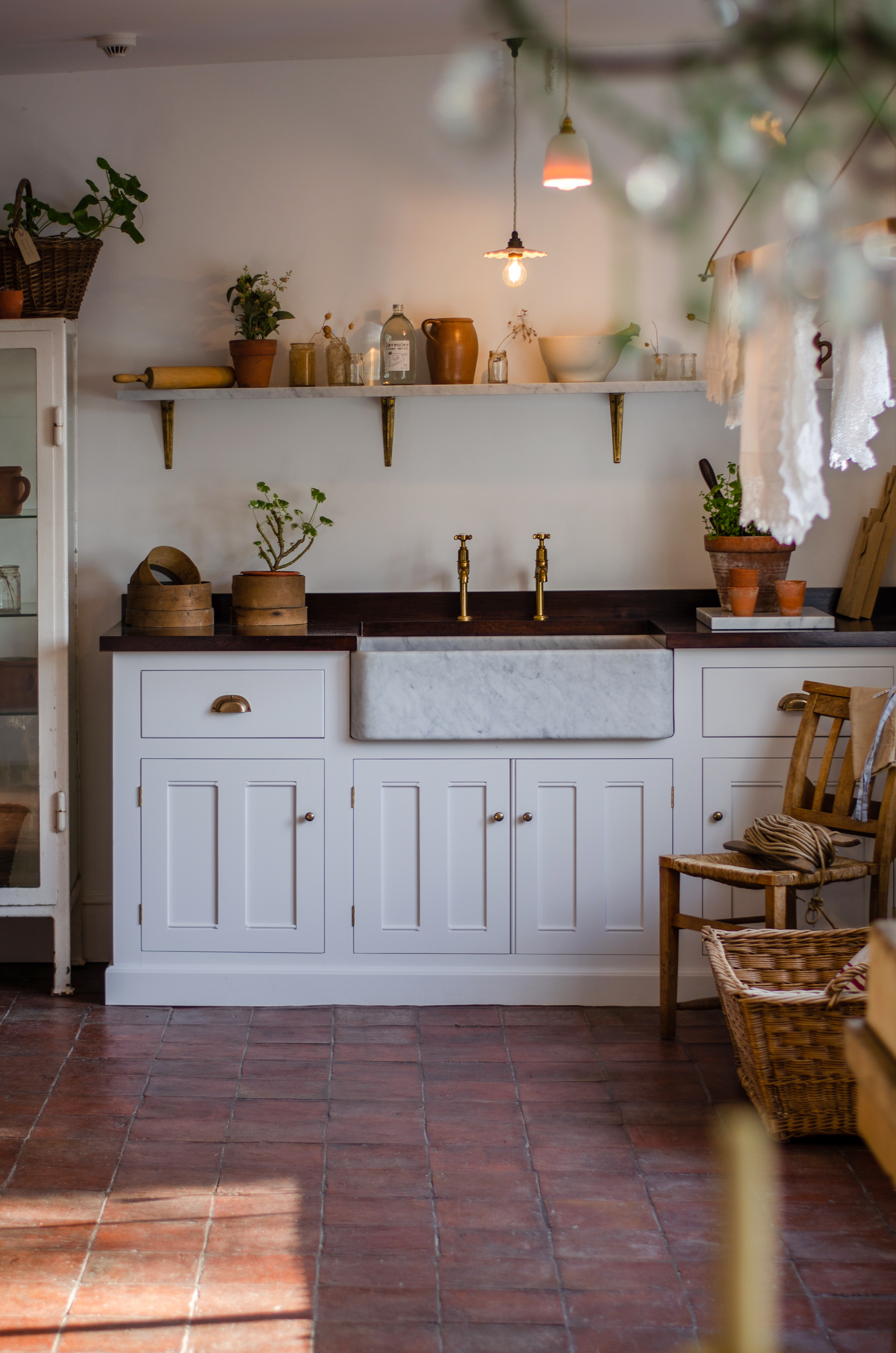 Our grand Classic Millhouse Scullery Kitchen accentuated with plenty of greenery.