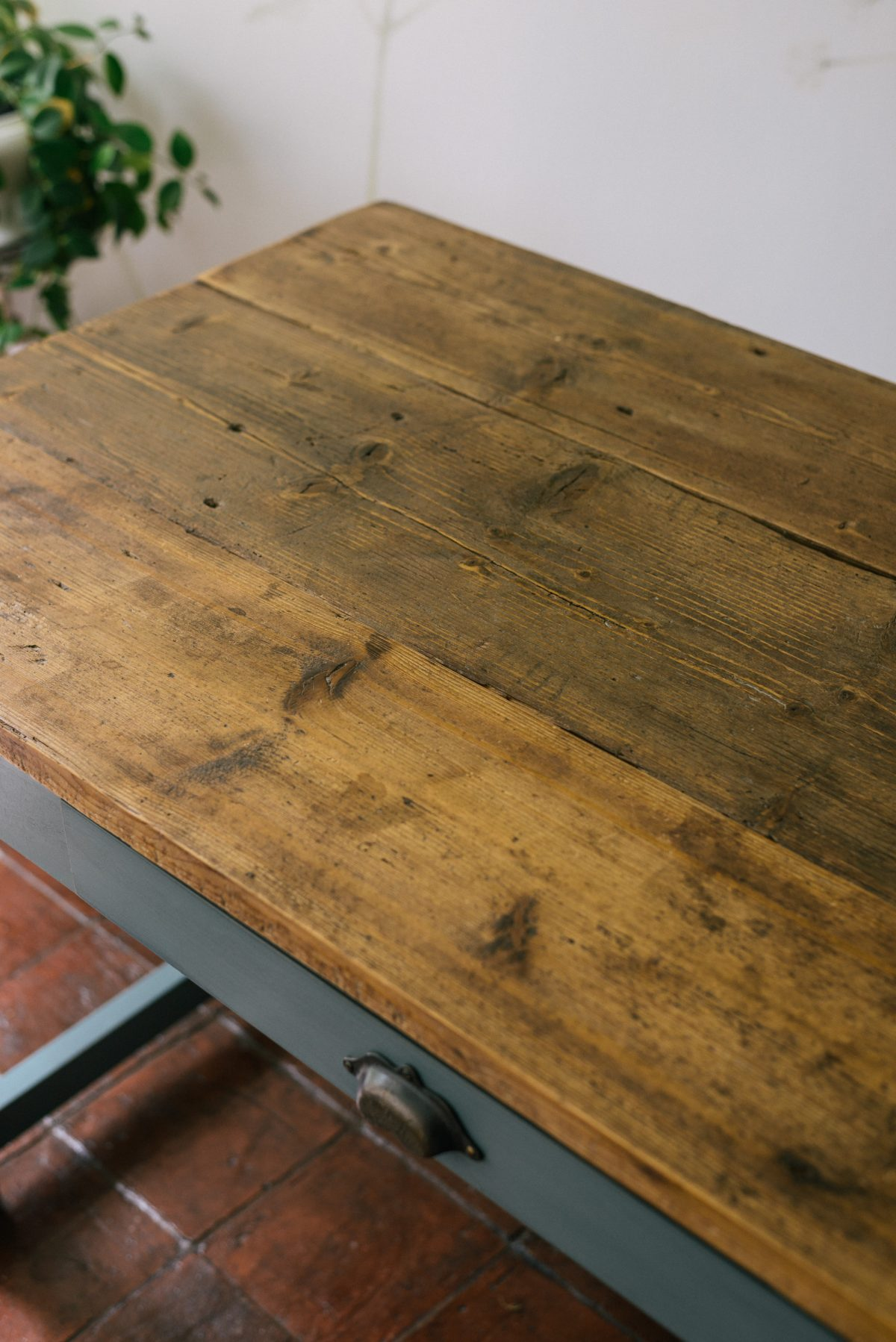 The tabletop is made from wide boards of reclaimed pine to complete the authentic, rustic look.