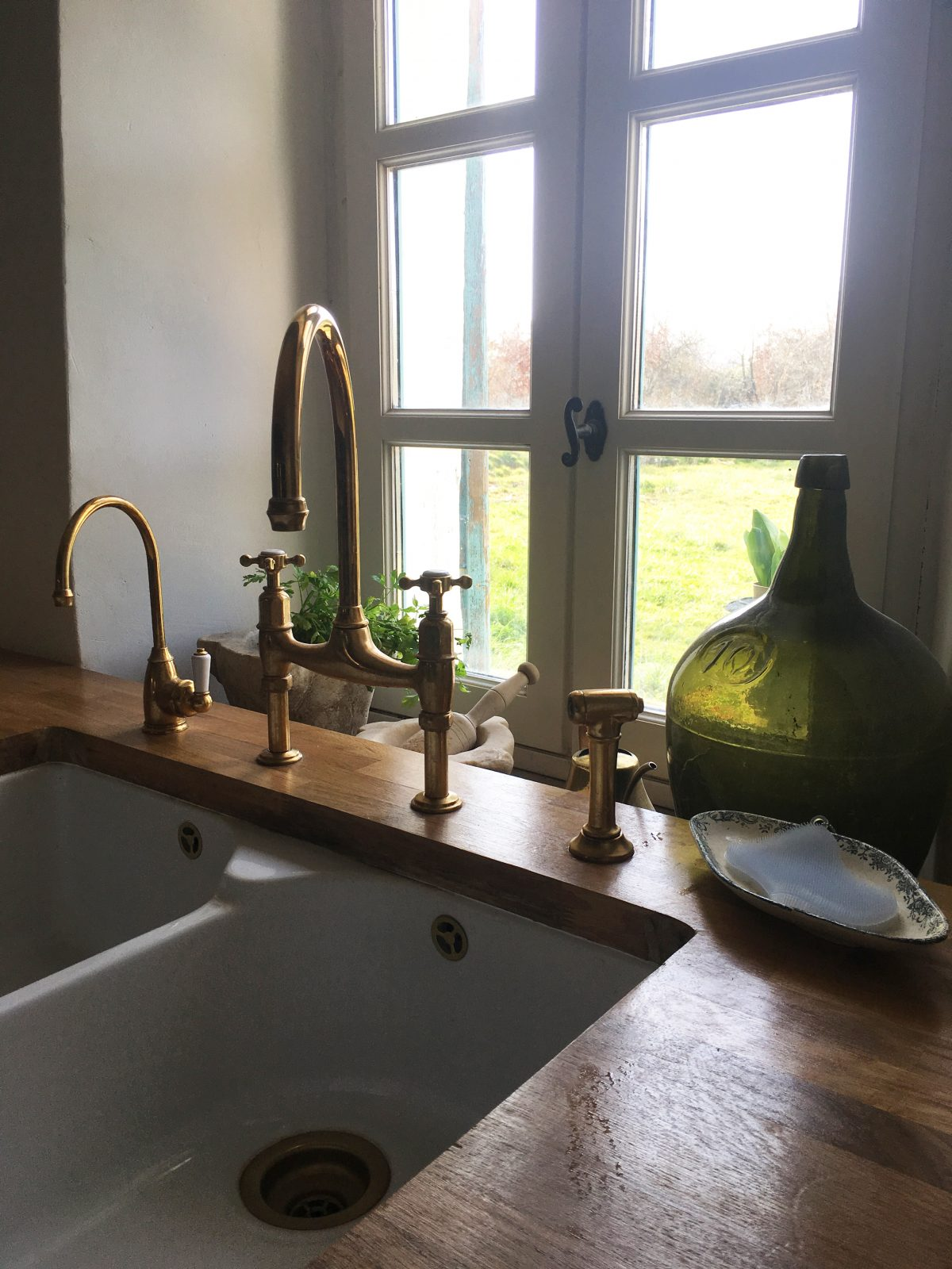 A deVOL Ionian and mini hot tap, both in our exclusive Aged Brass finish - made in collaboration with Perrin & Rowe.