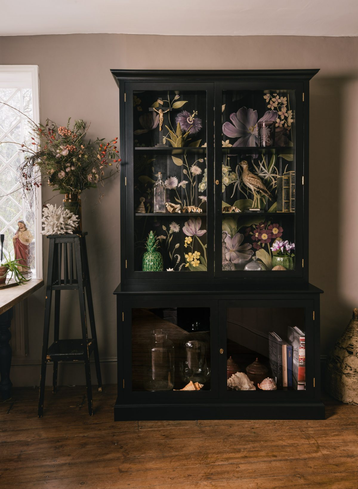 'The Botanical' design is so full of life and colour and we especially love it paired with a black painted cupboard.