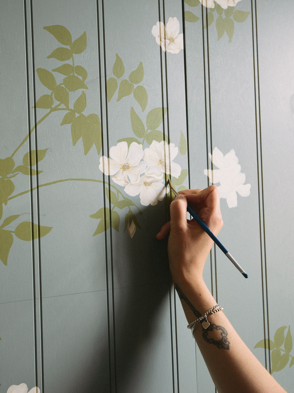 Our in-house Decorative Artist, Rosie, meticulously hand-paints each and every leaf and bloom.