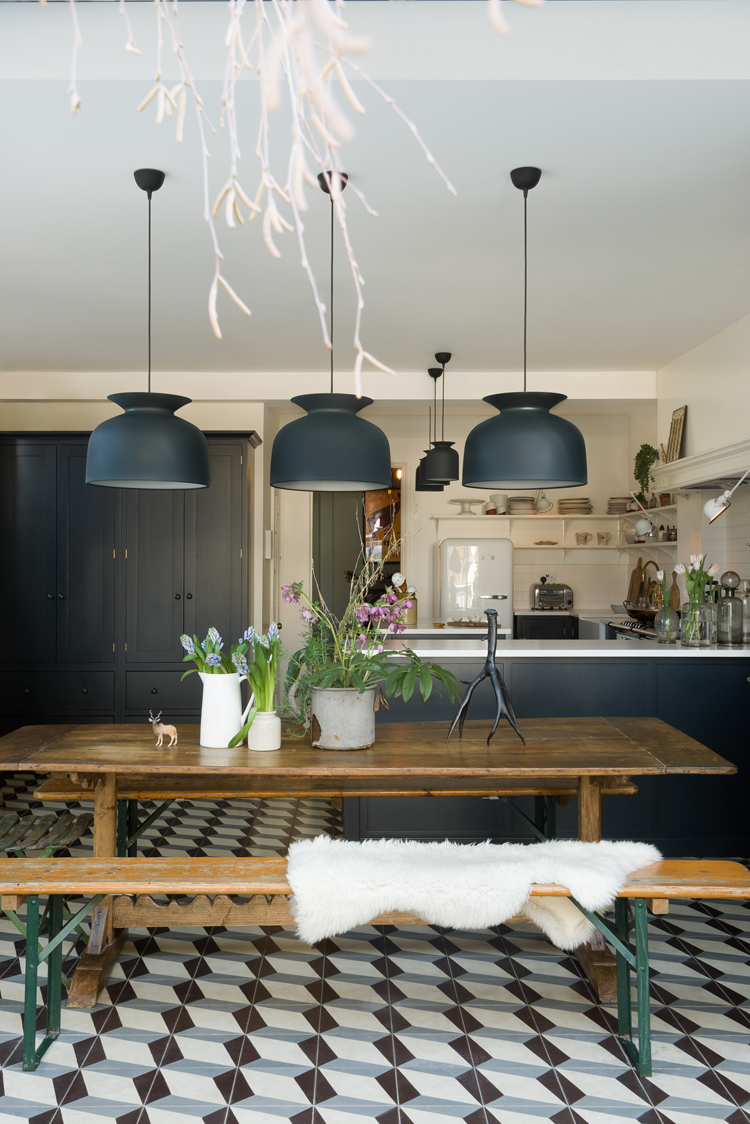 I love this vintage wooden table and bench seating in the Marlow Kitchen by deVOL